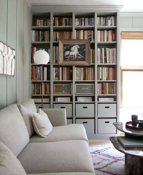 Making Nice in the Midwest matched her storage to her wall color to make for a more cohesive look. PS: Nice Burrard sofa.
