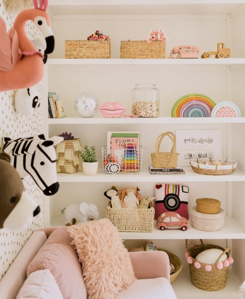 A Beautiful Mess's beautiful toy storage system, featuring our Pink Matrix sofa.