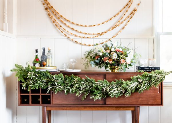 Colleen Jeffers of The Good Drink dressed up her V-Bar sideboard with a DIY holiday garland of her own.