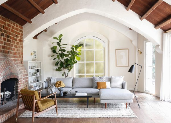 We love how Kate Davidson has kept her furniture choices cool and neutral against her many-textured living room.