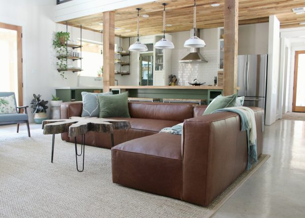"""Wow this room has """"elegant nap"""" written all over it. We love the sage green color with our lustrous modular Mello sofa in dark brown."""