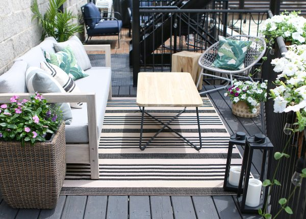 DIY Playbook paired their Arca sofa with the fun and fresh Bene lounge chair, making the most of their small patio space.
