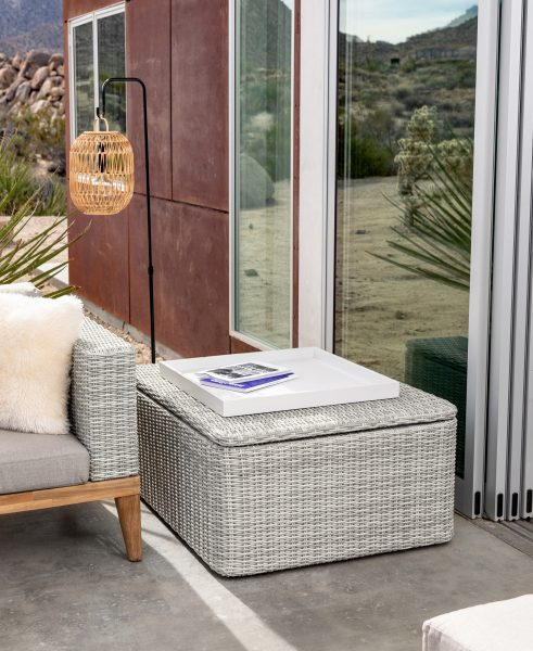The Ora coffee table doubles as weather-resistant storage. Made from weather-proofed wicker and lined with polyester fabric, the Ora helps keep your blankets dry and your coffee cup steady.