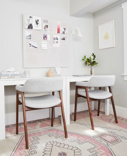 The light seats contrast beautifully with the dark walnut color of the Savis chairs. Shira Gill pulls them up to her desk to get some work done, and then spins them around to entertain company.