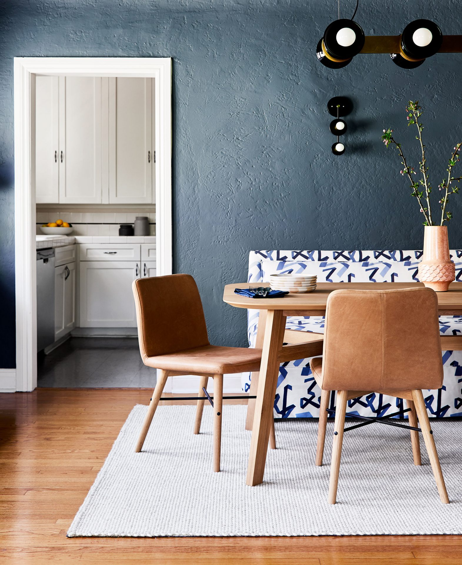 Dining room designed by Emily Henderson featuring the leather Kissa dining chair.