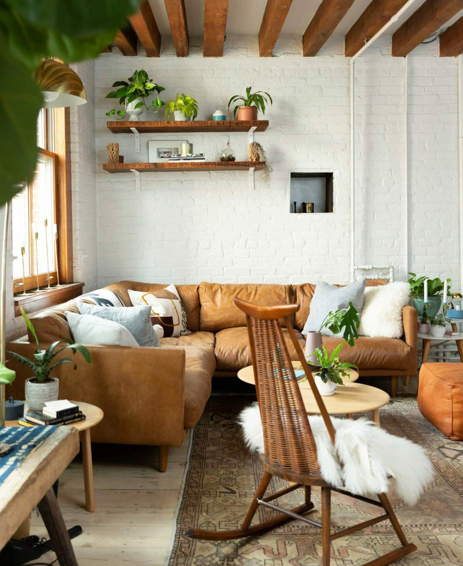 Marika Frumes' New York apartment with leather Article sectional sofa