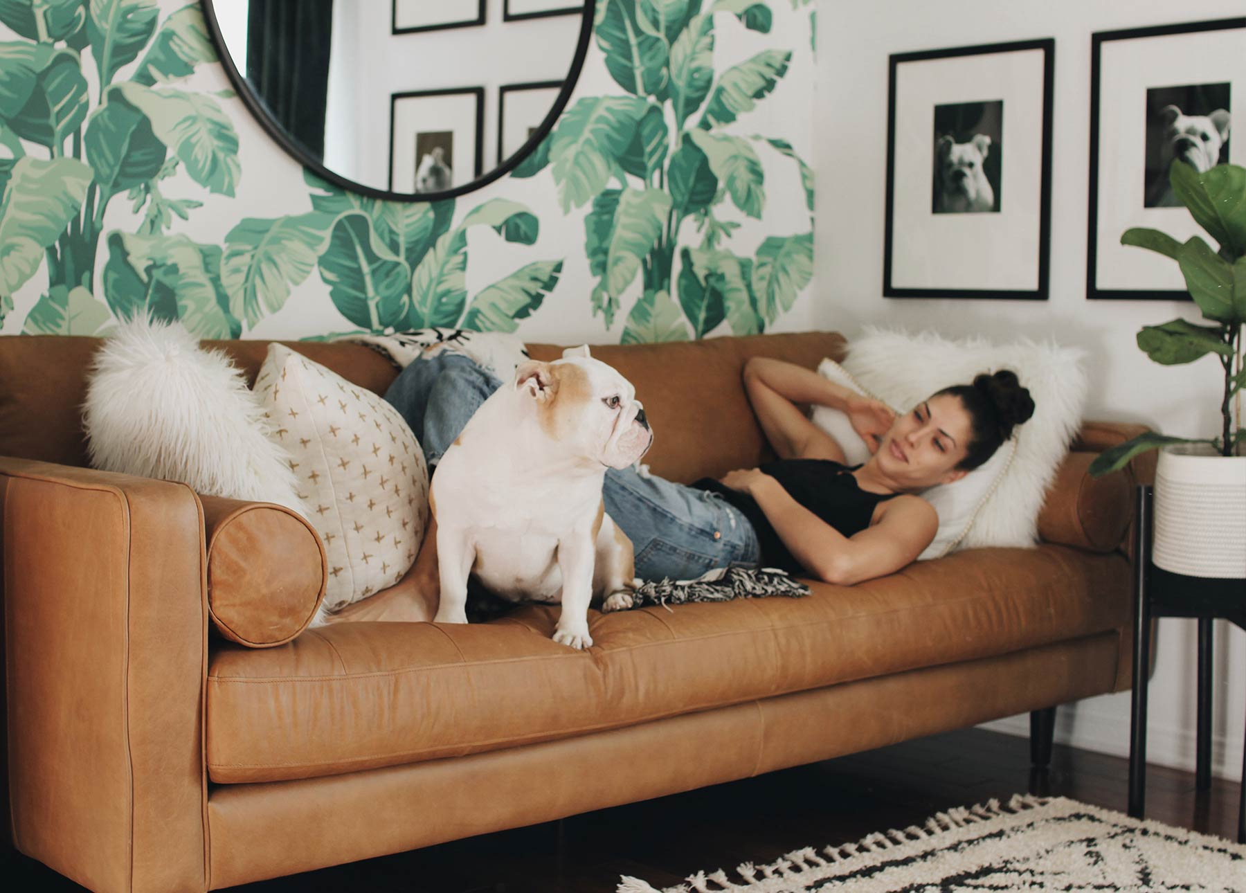 Rachel Metz relaxes on her Article Charme Sven leather sofa with her bulldog