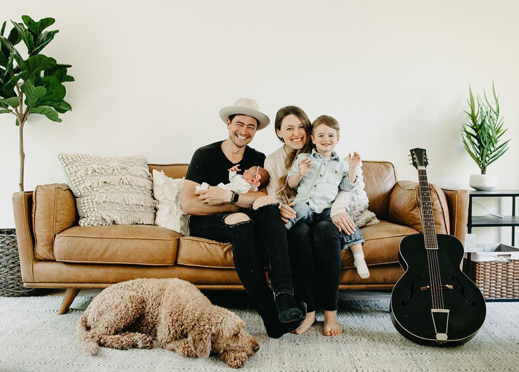 Entertaining trends - family sitting on a brown leather sofa