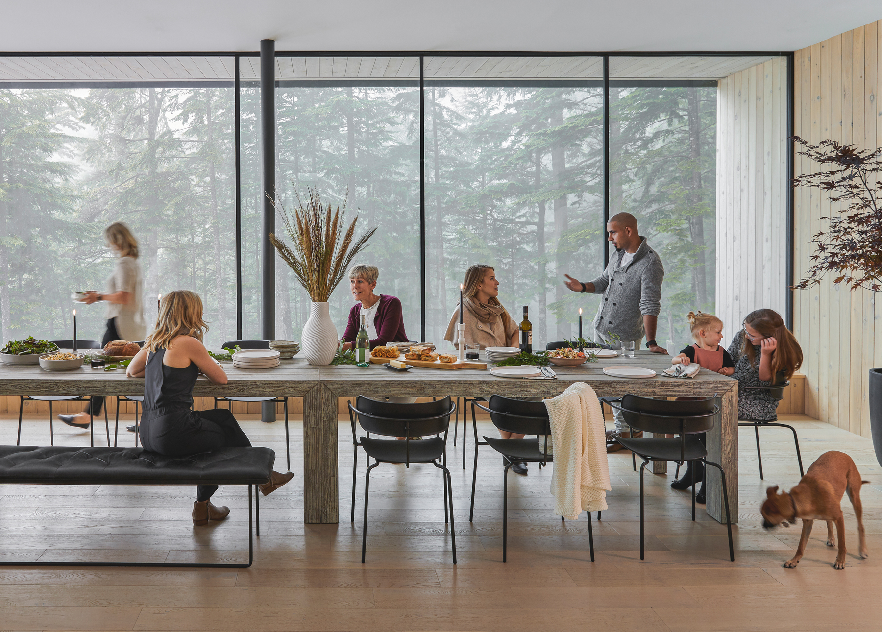 Family and friends eat dinner at the Article Atica dining table
