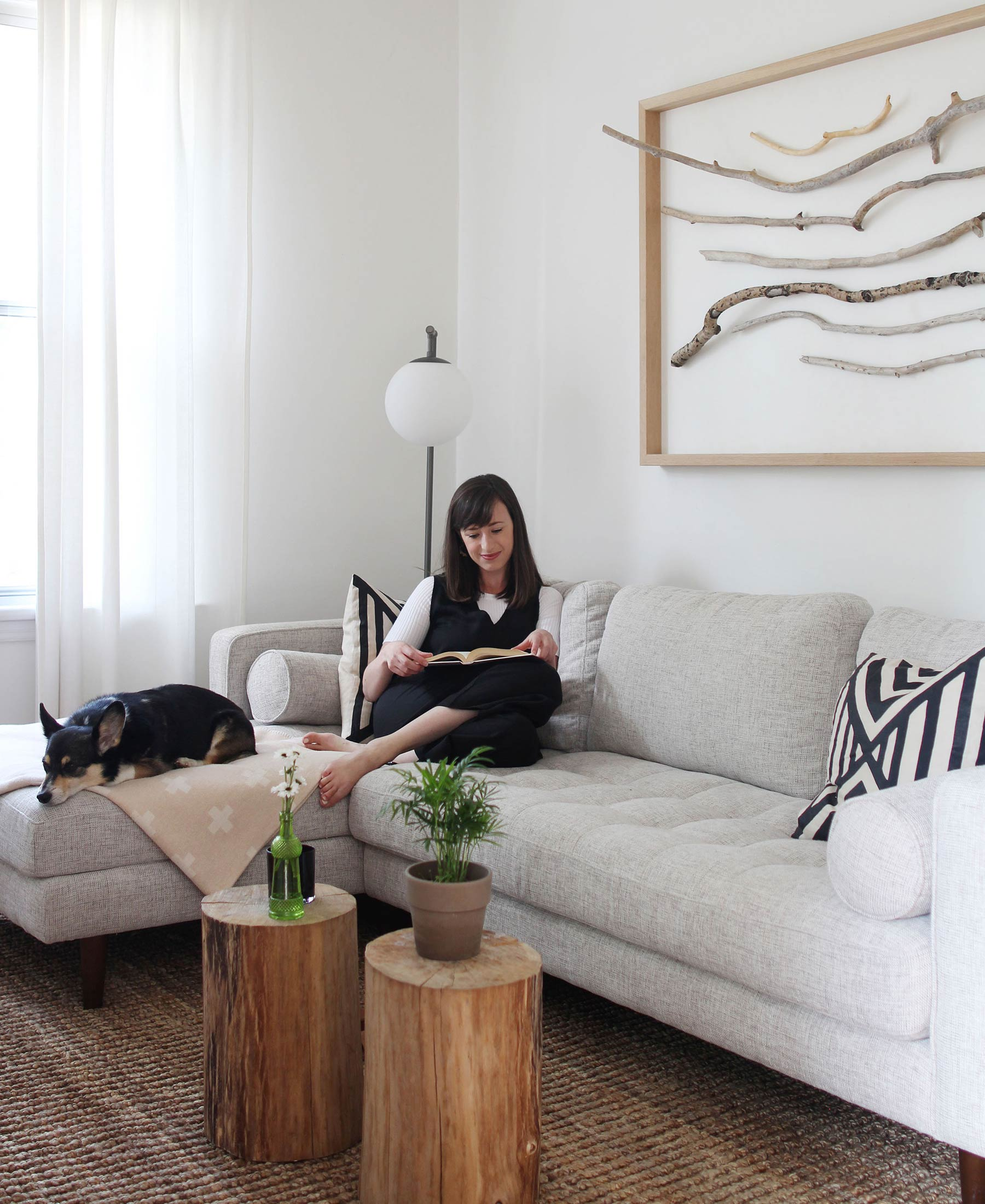 Style Bee enjoys her Sven in Birch Ivory sectional with her dog.
