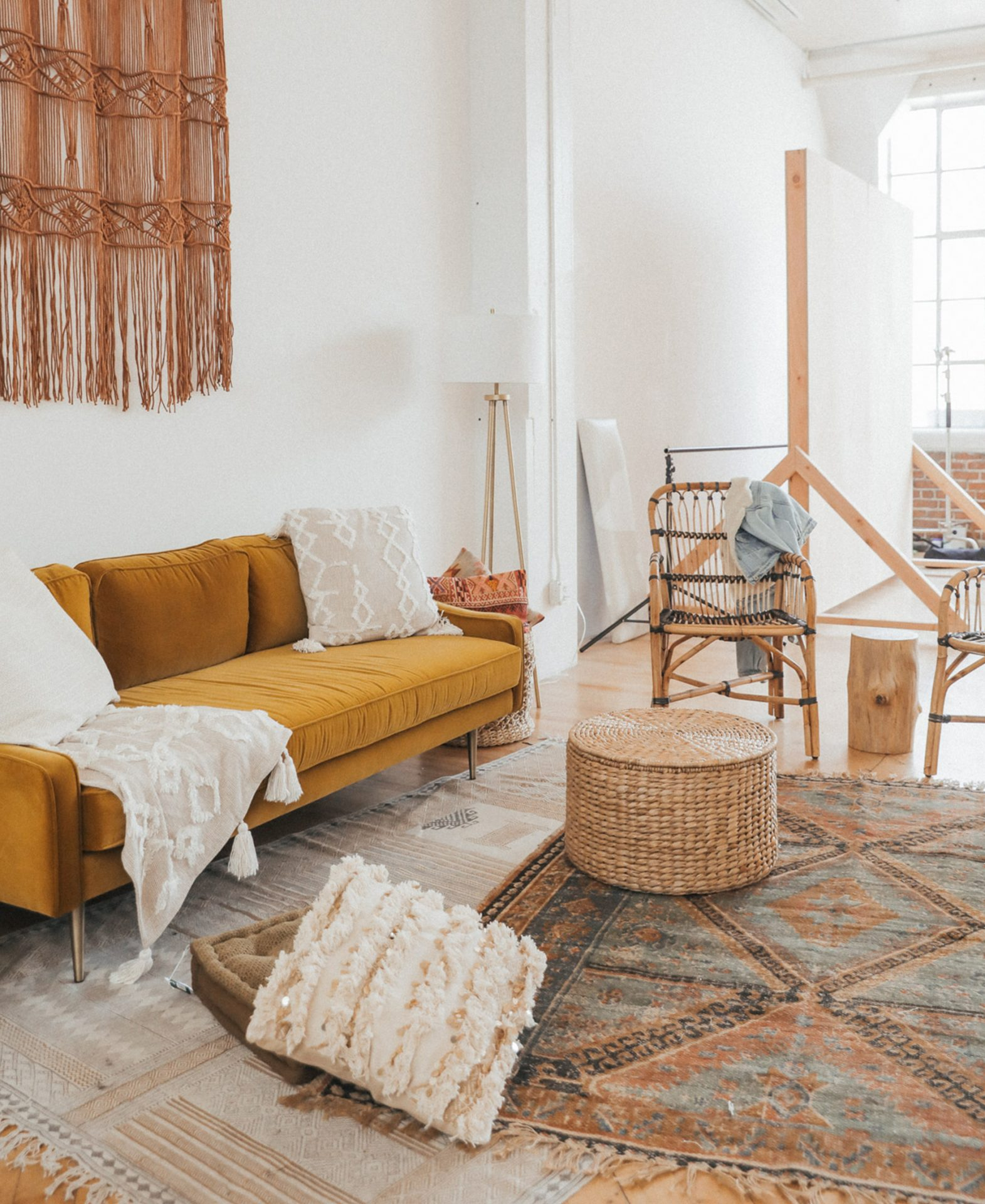 Blogger Advice From A Twenty Something's boho living space features a yellow velvet Article sofa. It's obvious she knows how to clean a velvet couch!