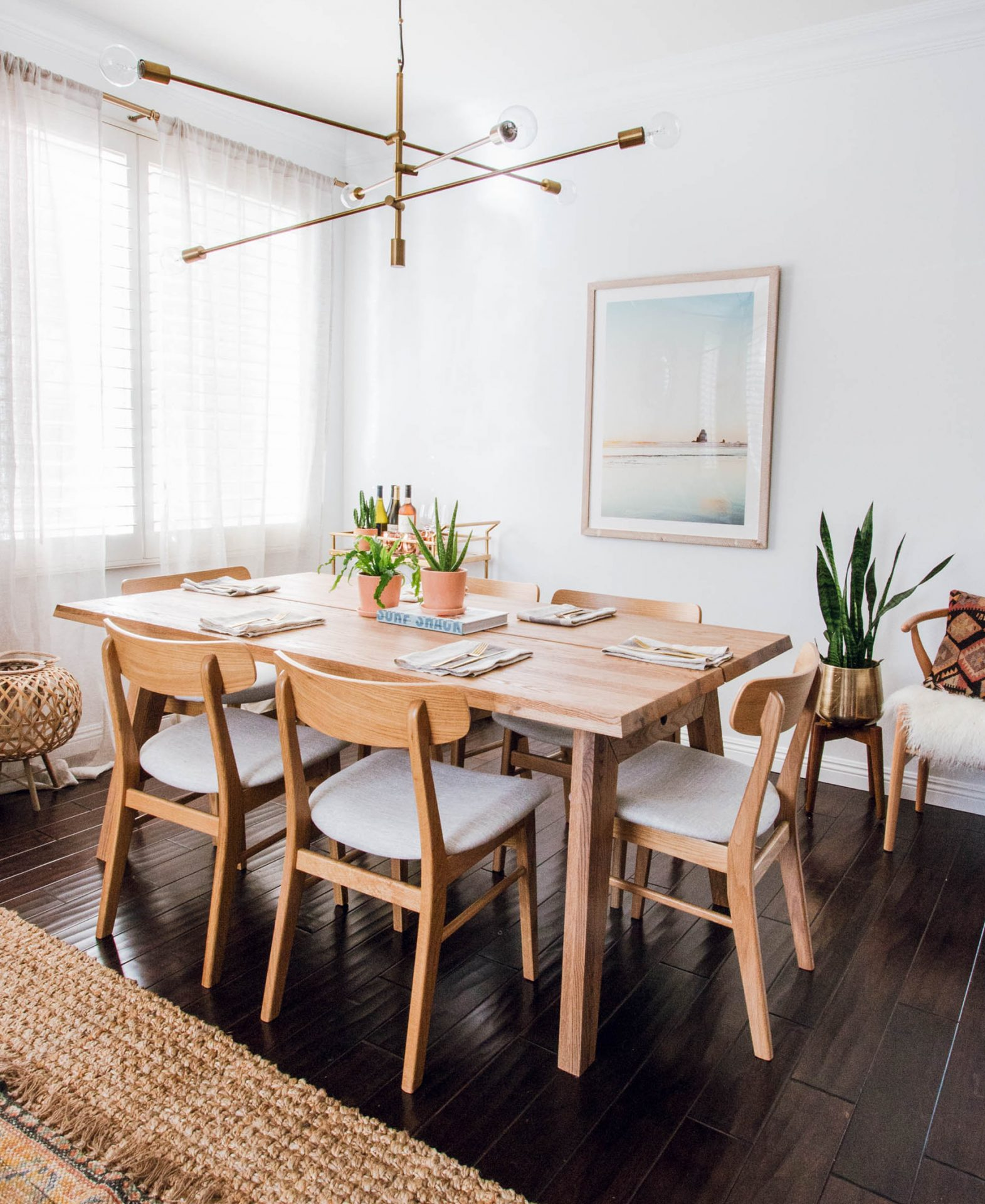Blogger Anita Yokota's dining room features mid-century modern furniture, plants, and natural materials.