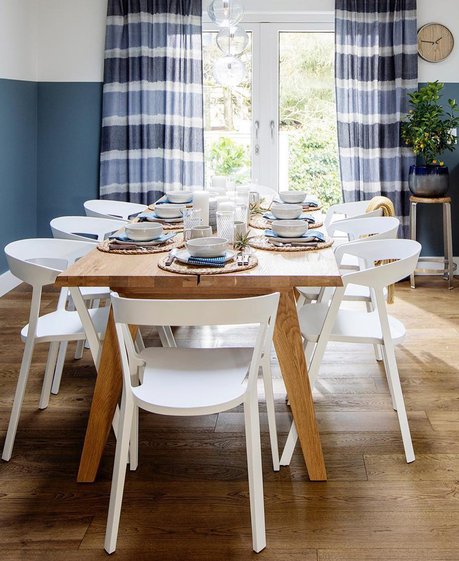 Love It Or List It featured this dining room with an Article Madera table and white chairs.