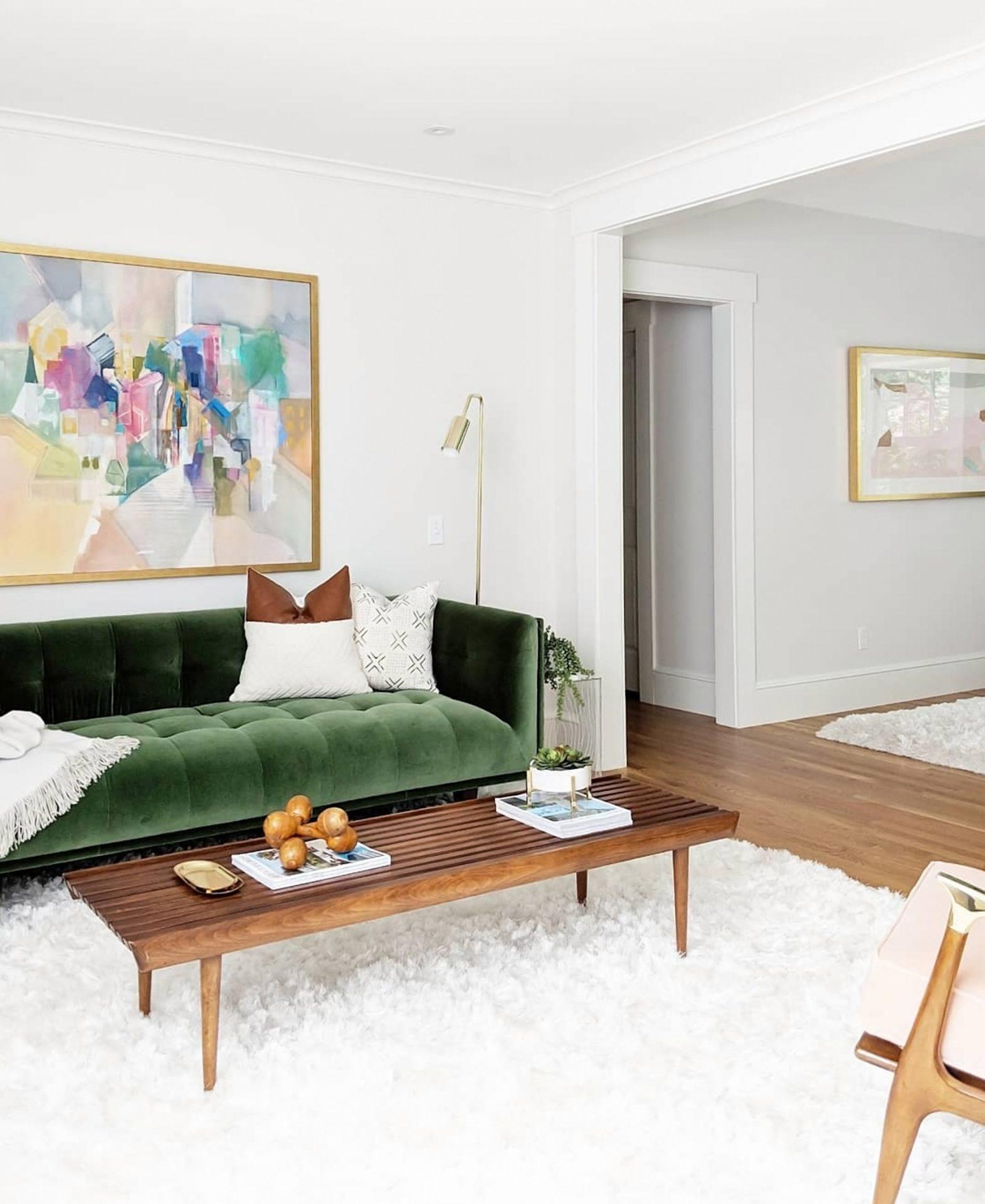 Gemma van der Swaagh shows off the grass green velvet Article sofa in her bedroom.
