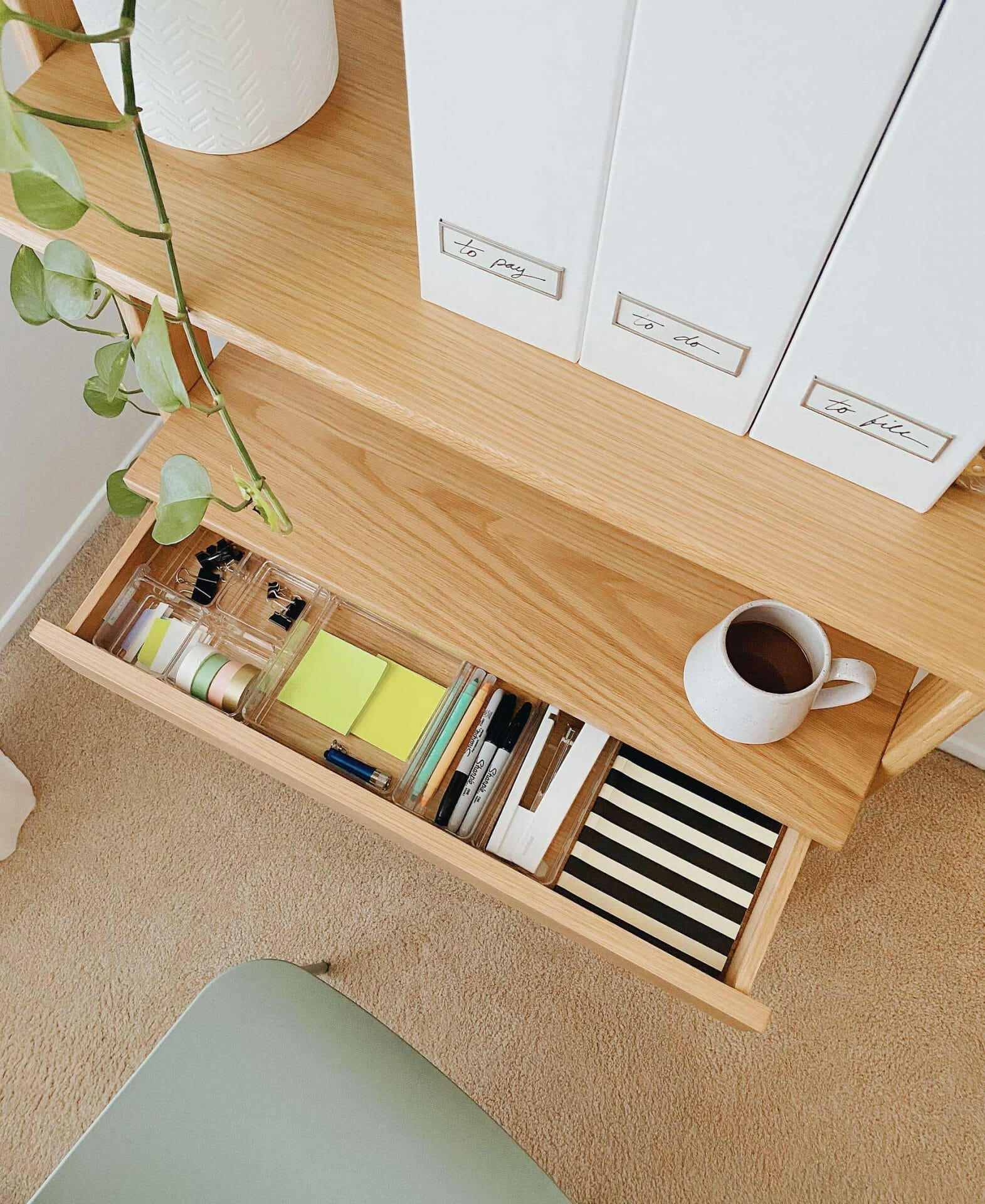 Monica Leed's Lignum shelf desk drawer is perfectly organized and clutter free.