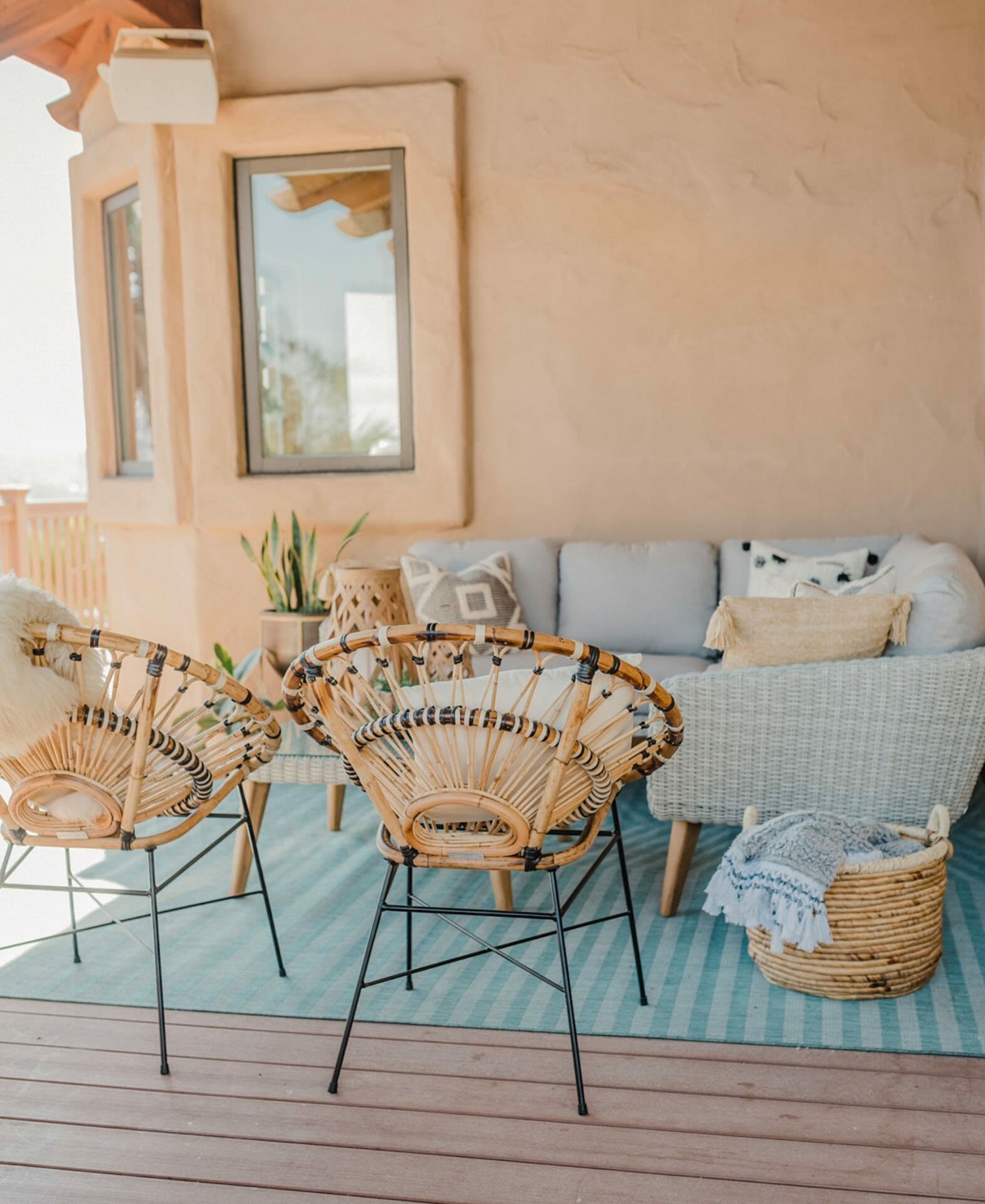 Blogger Navy Grace keeps their natural and synthetic wicker under a covered patio.