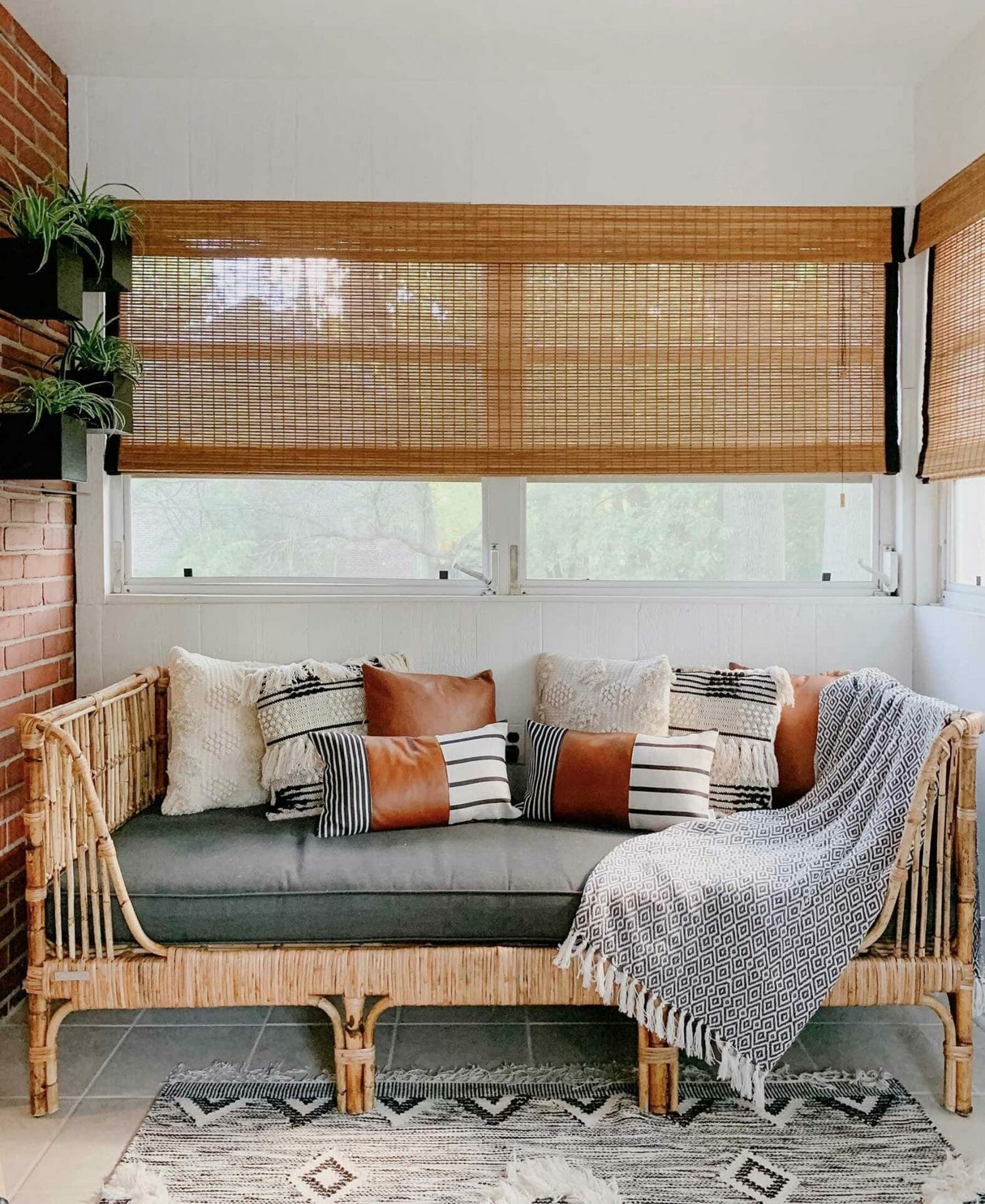 A sunroom features Article's Sol Daybed.