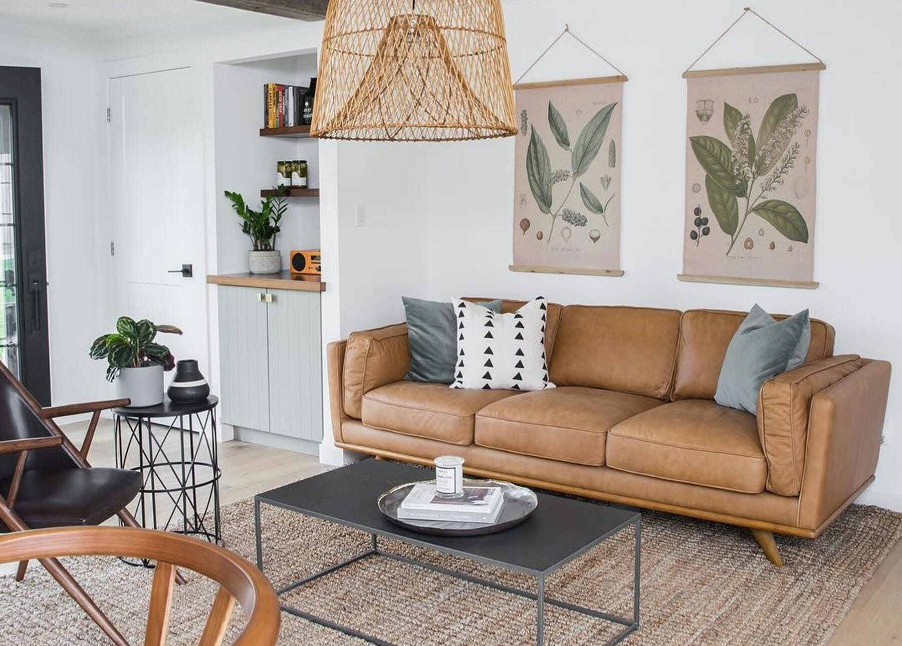 A living room features the Article leather Timber Sofa and botanical art prints.