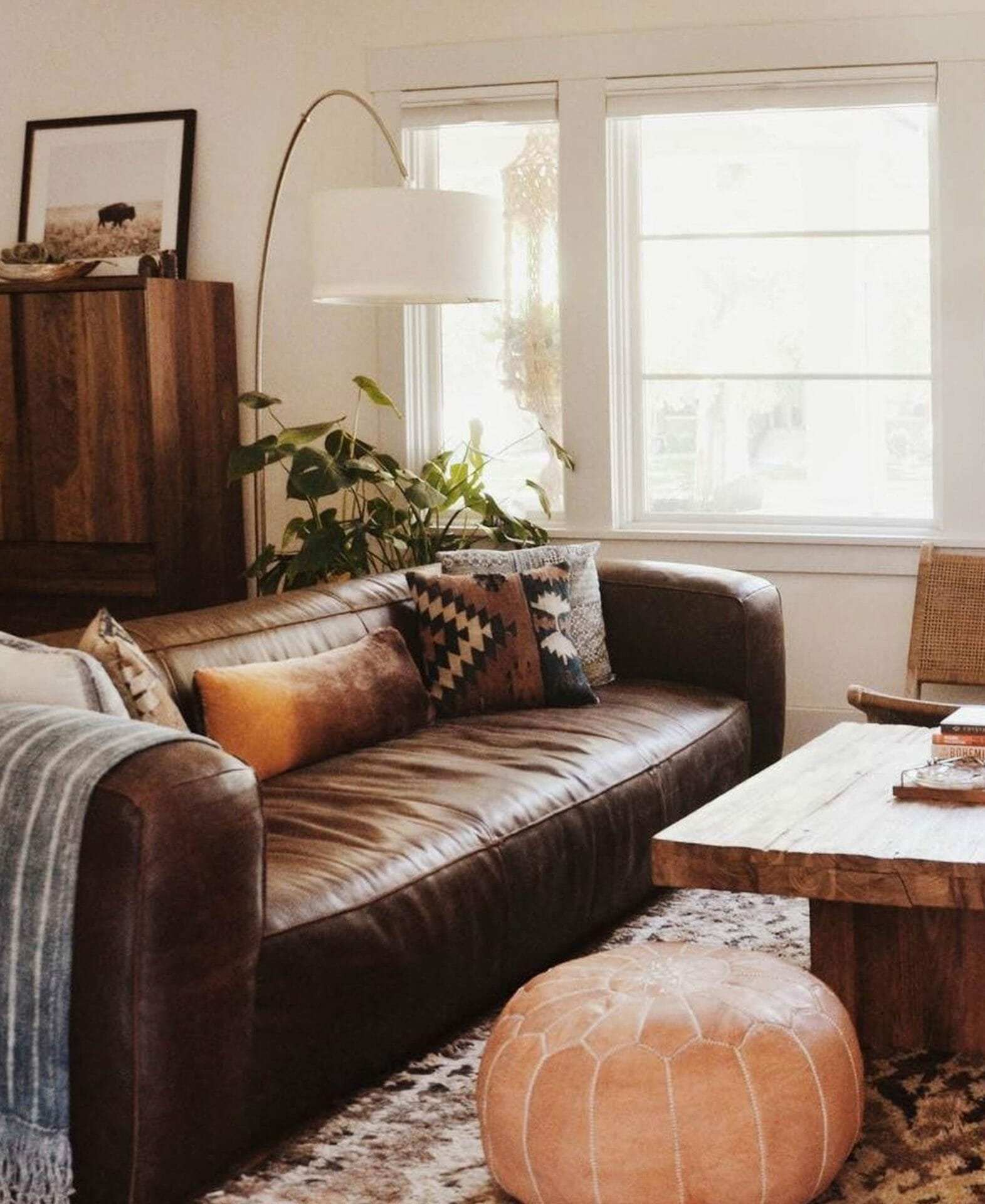 The dark brown leather Article Cigar Sofa creates a cozy space in Bridget of BeCrowBe's living room.