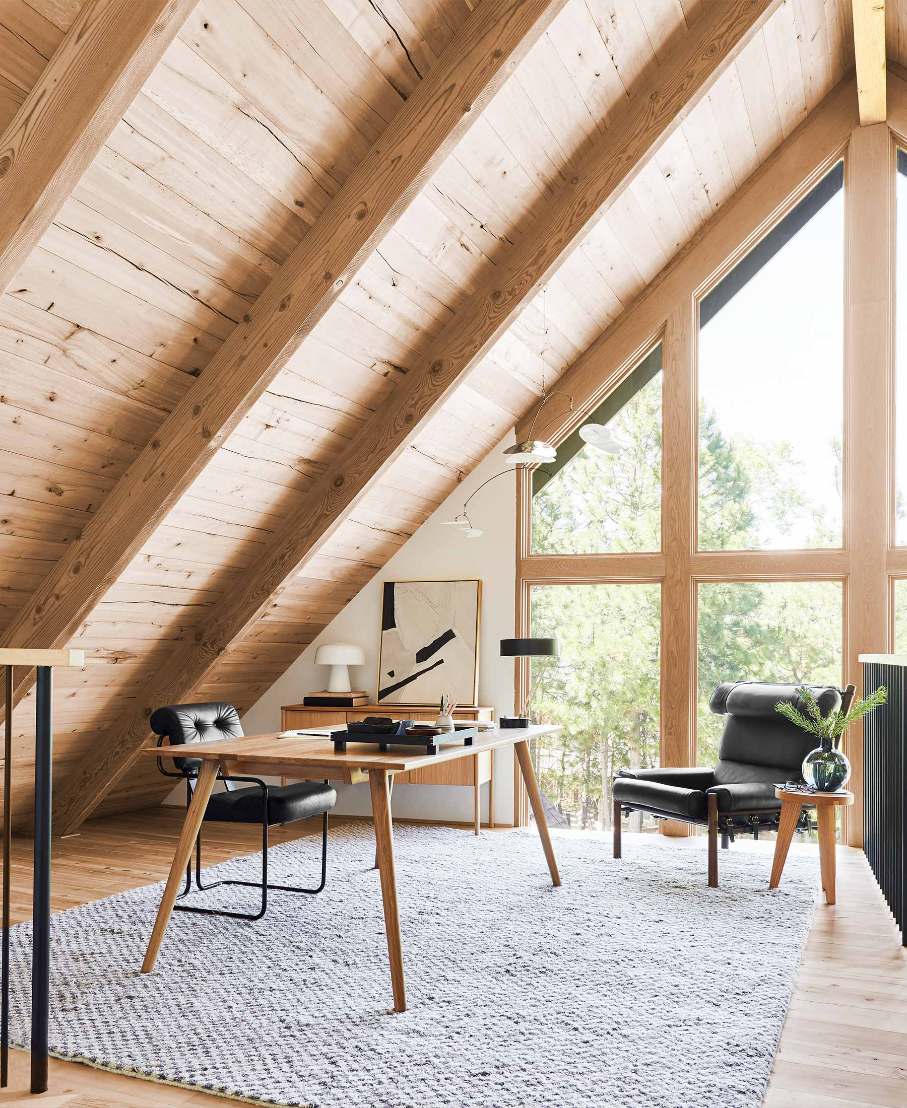 A wood and beam ceiling is featured in this home office space