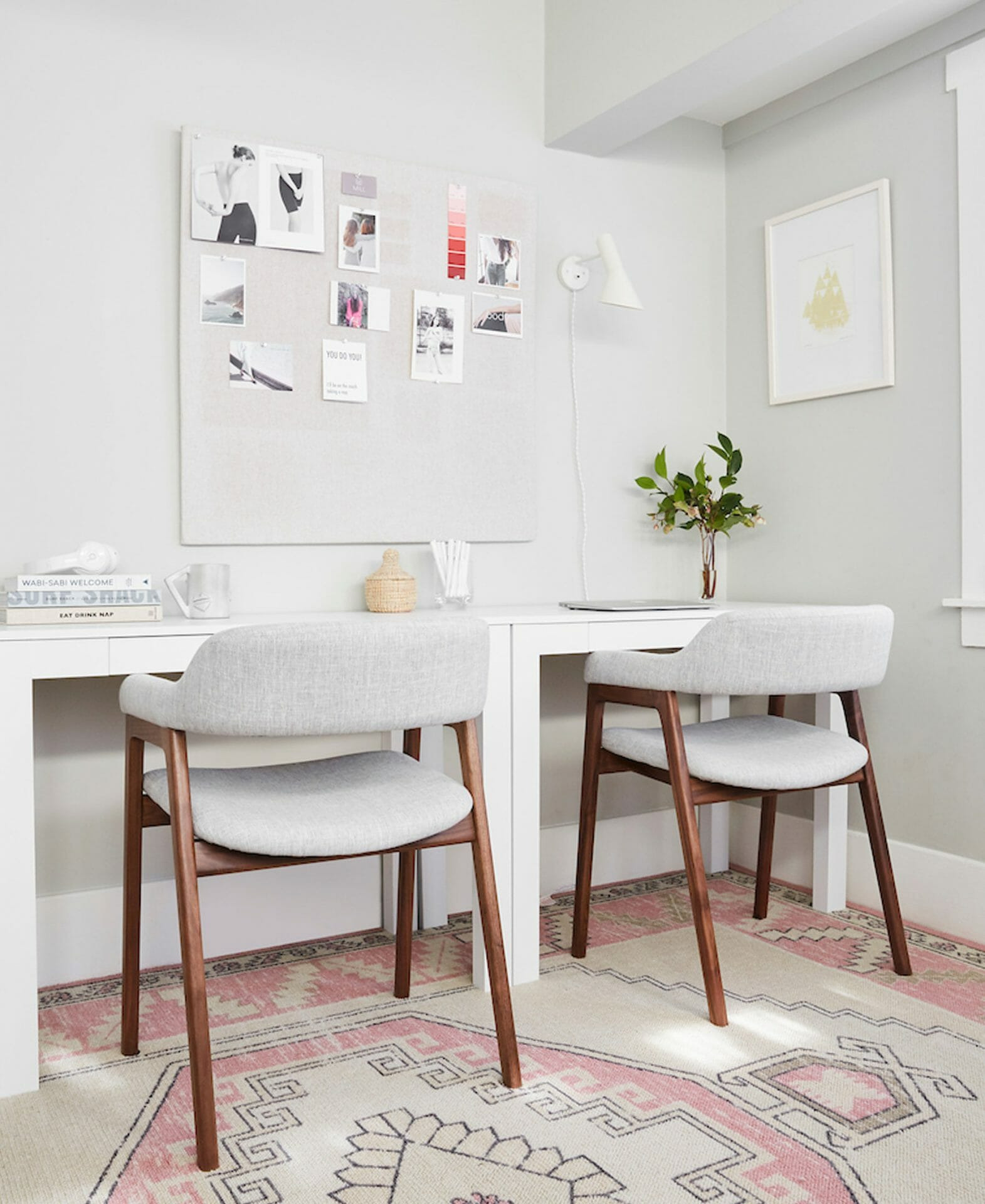 Two Savis Chairs and two white desks are seen in Shira Gill's home office.