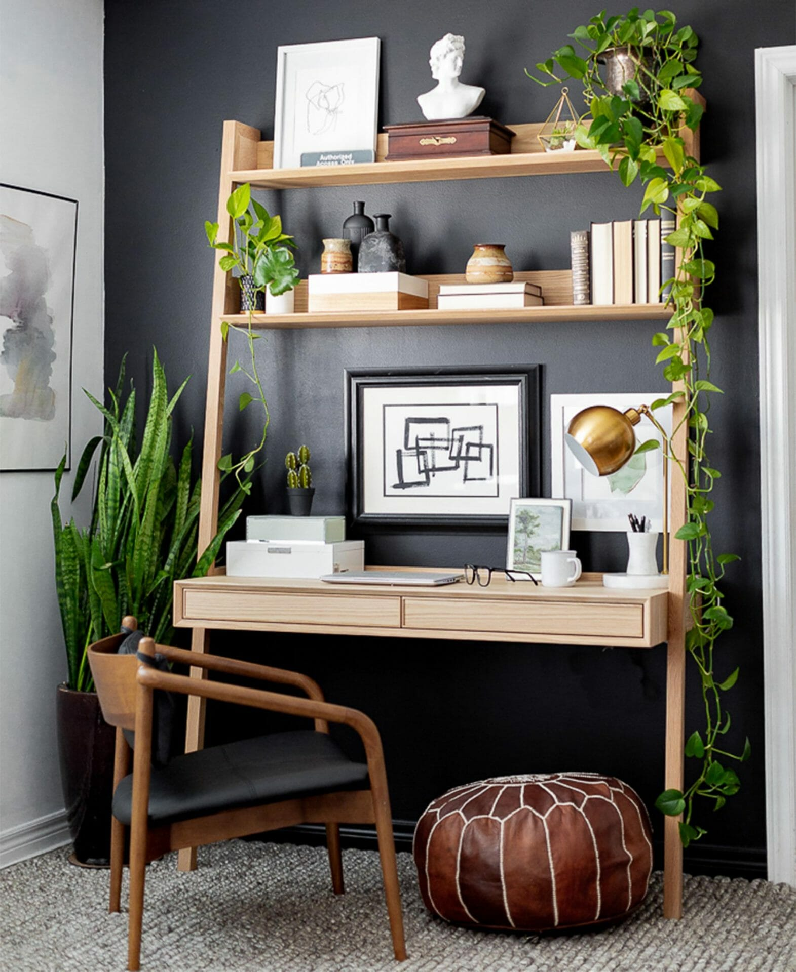 A Fantol Desk is shown against a dark wall with plants and Lento Chair