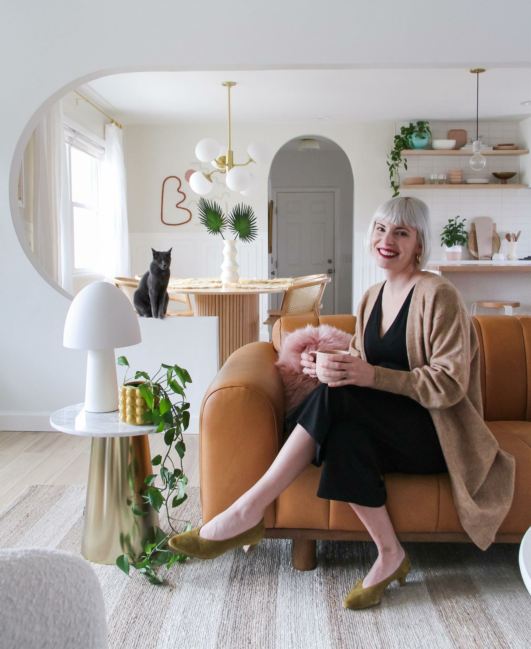 Brit Arnesen of @britdotdesign sits in her modern eclectic living room
