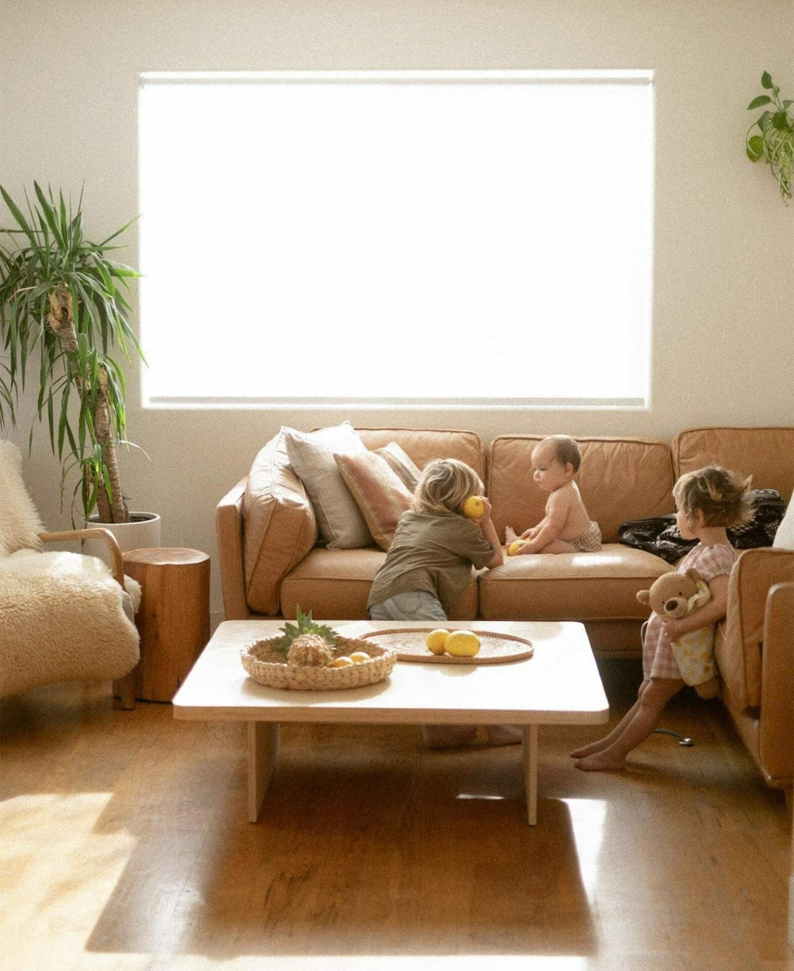 Yuna Leonard's bright space shows her children playing on the Timber Sectional from Article