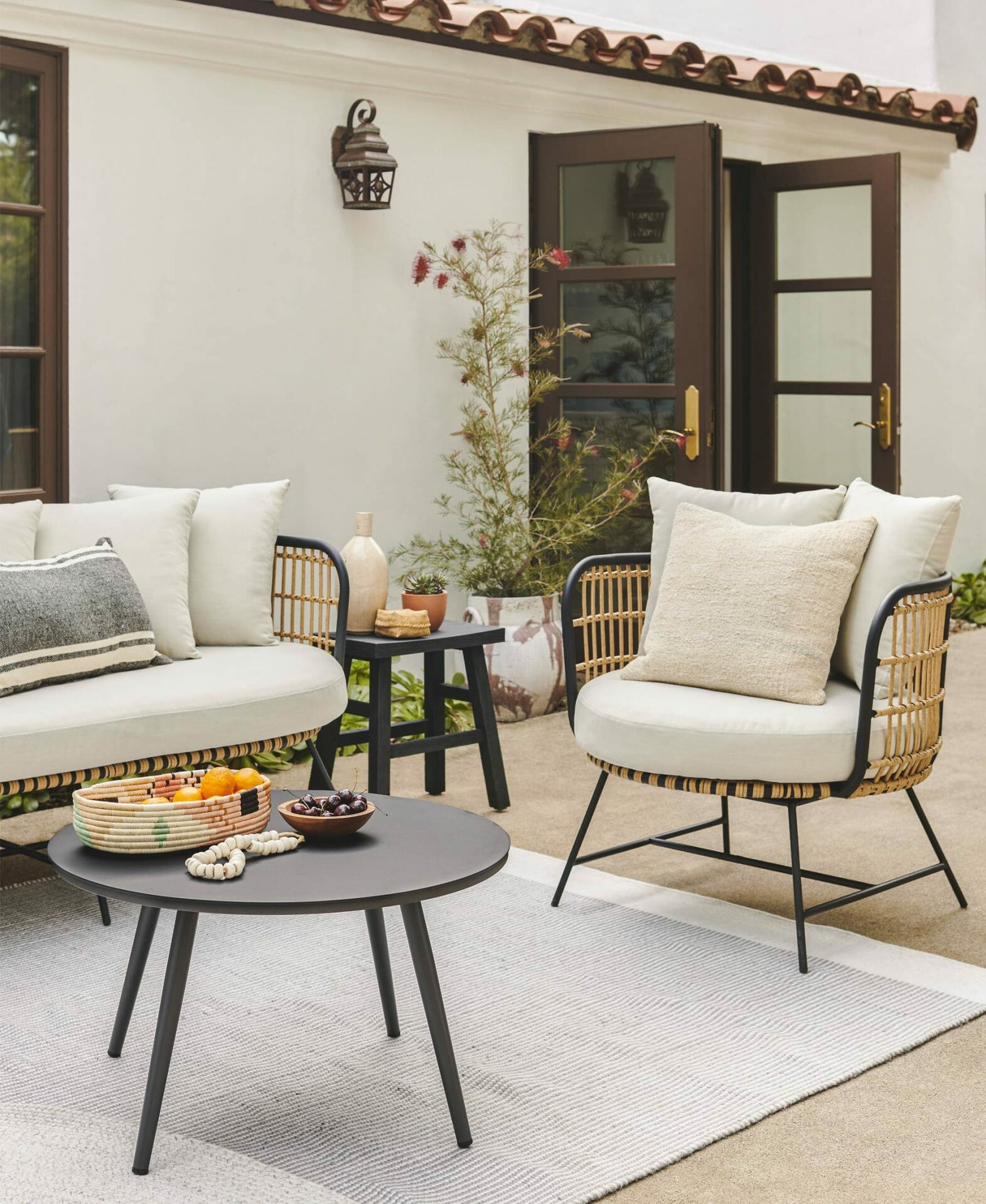 The Onya Set and Redondo Rug are shown next to a Spanish style villa.