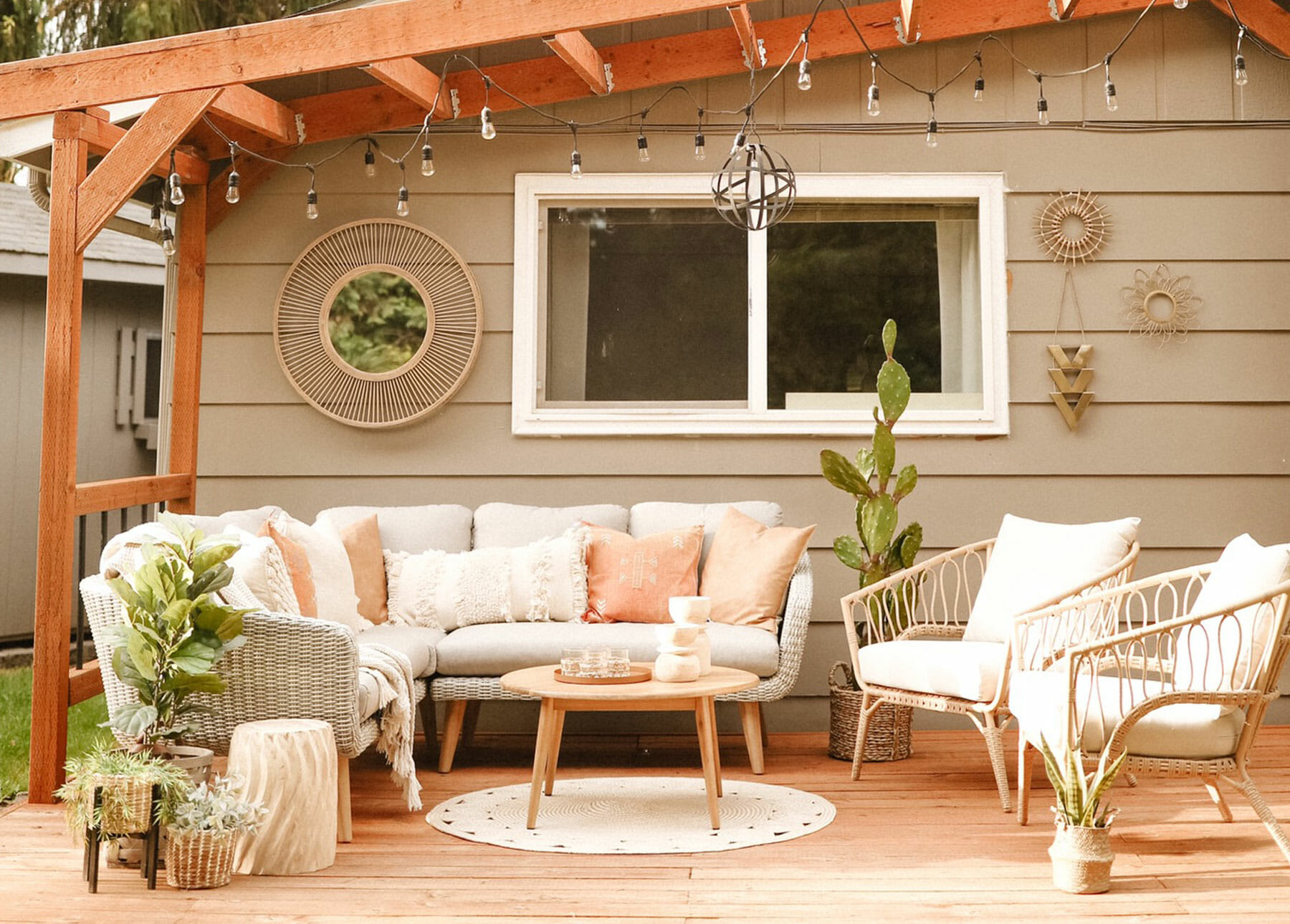 The Ora Sectional sits on a porch with a cedar awning