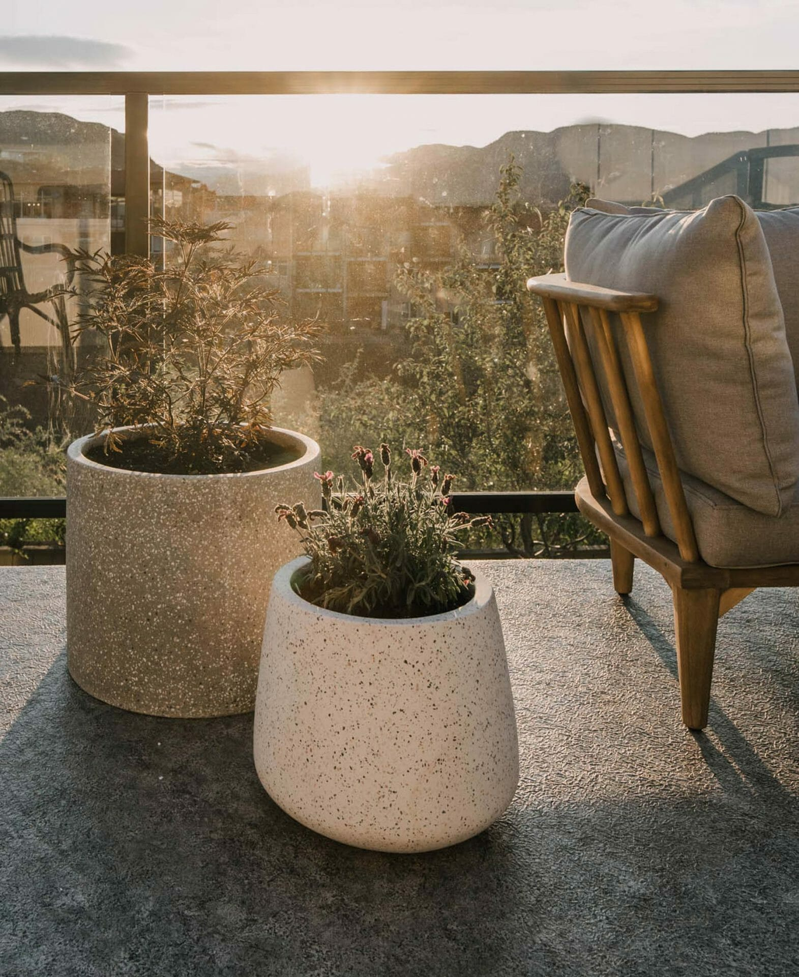 Blogger Lemon Thistle's apartment balcony is seen with two Article terrazzo planters.