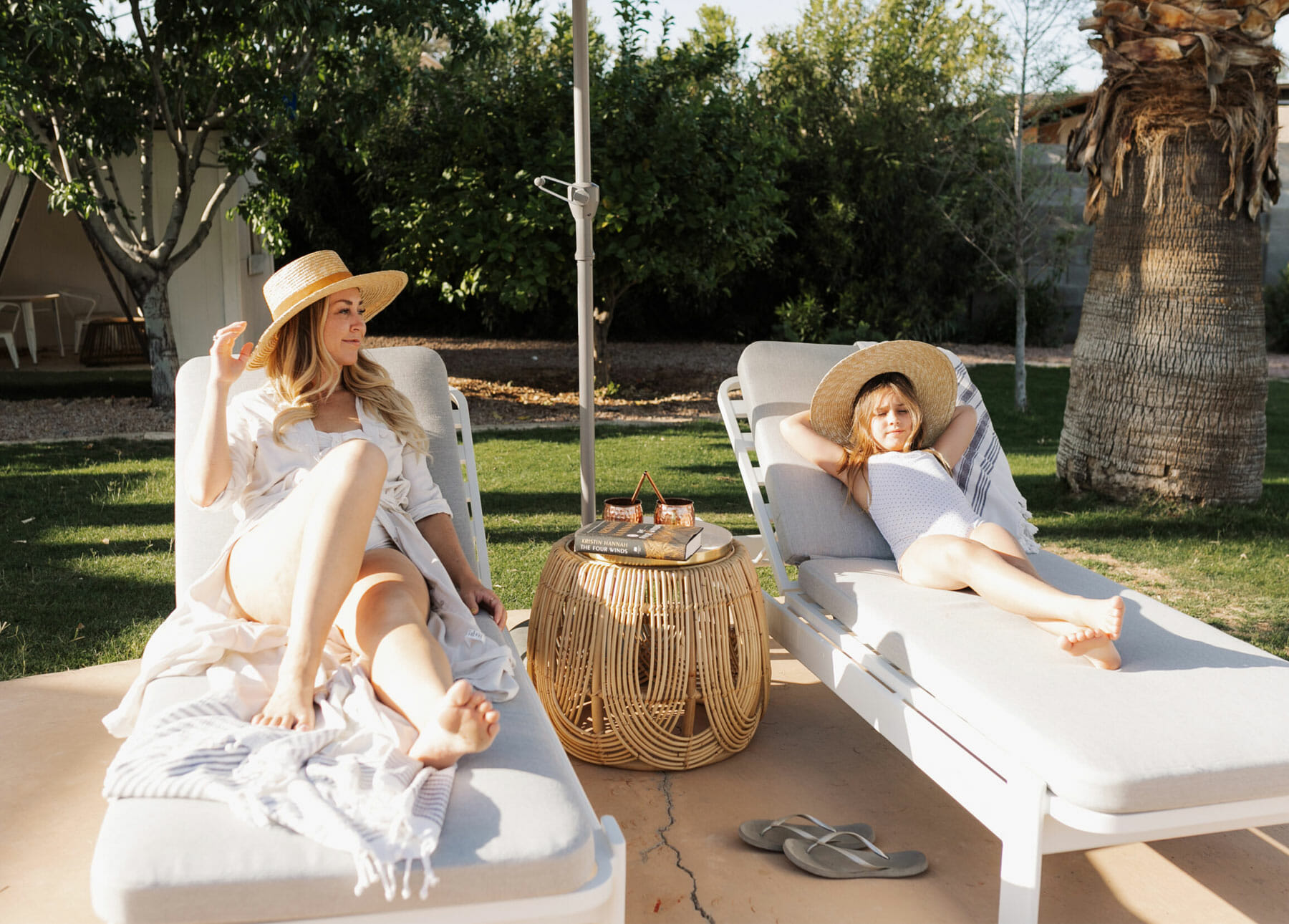 Blogger Paige of the Love Designed Life relaxes on a lounger with her daughter.