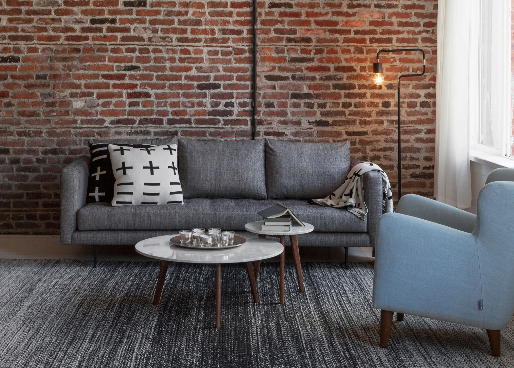 The Parker sofa is structured, but casual and looks right at home in a  chic, urban loft.