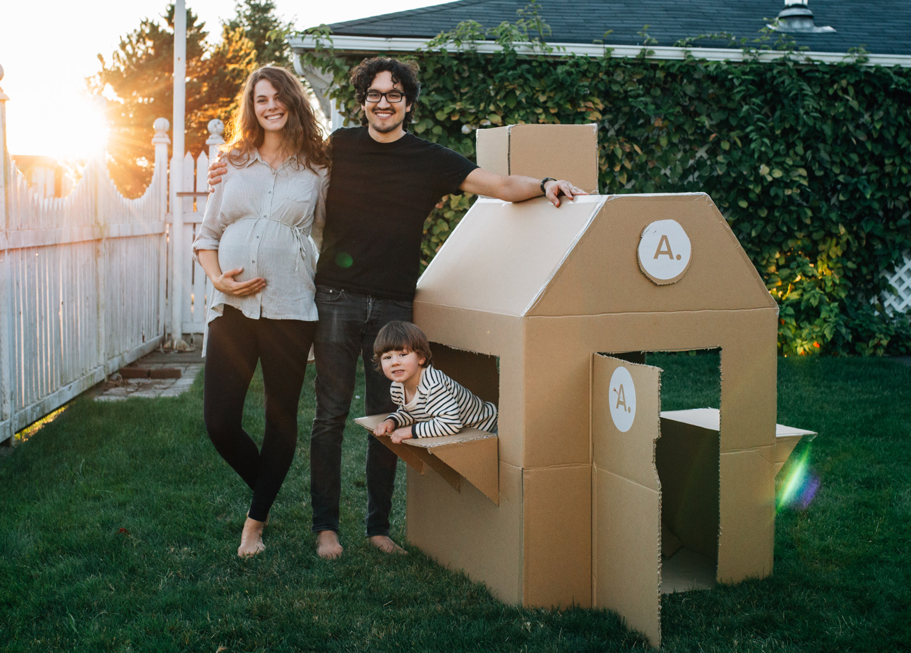 Jorge, Emmy Lou, and Matthias all pose excitedly with the fully completed box fort.