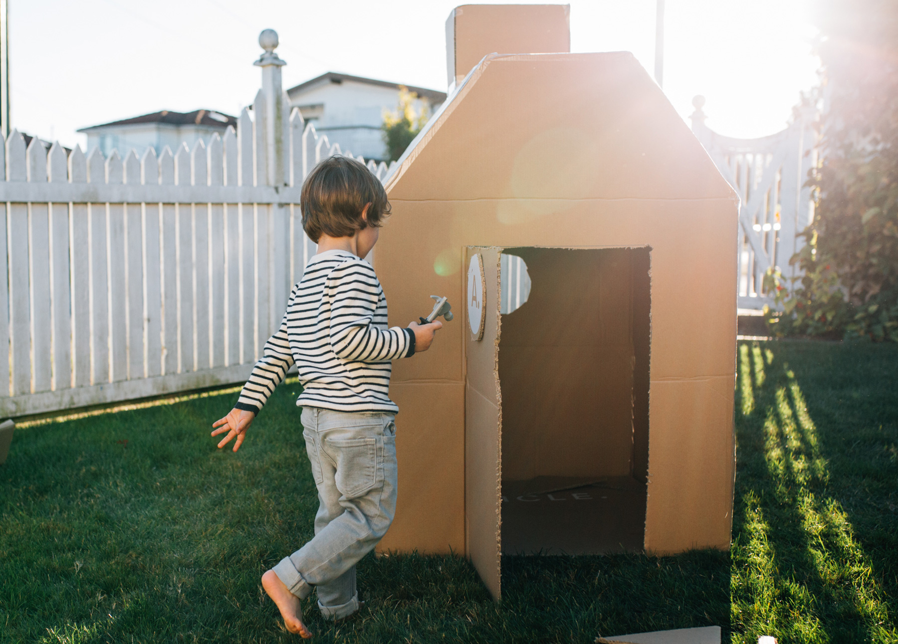 A child playing with a completed box fort
