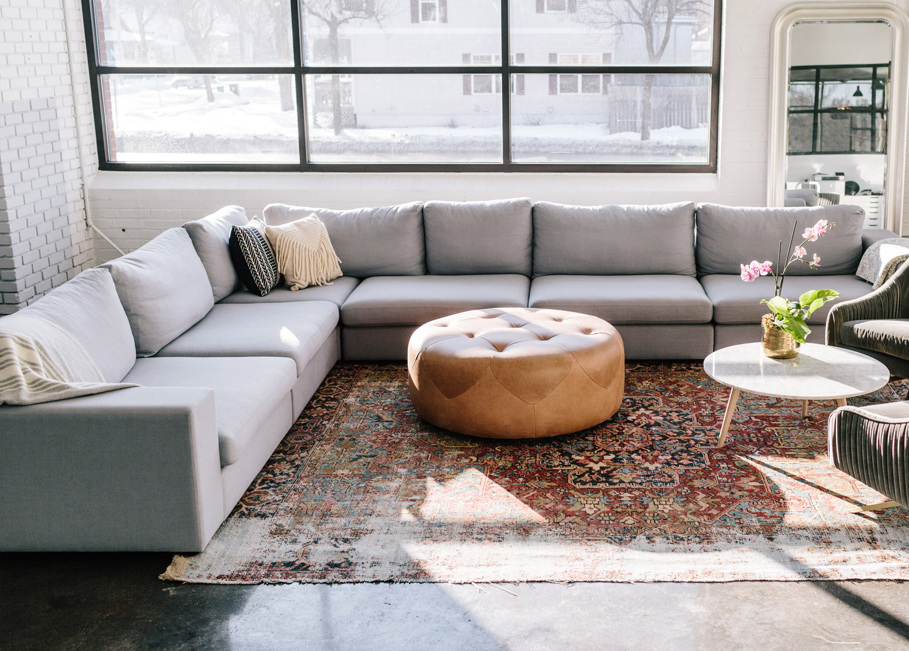 A large, modular sectional makes a big impact in a space.
