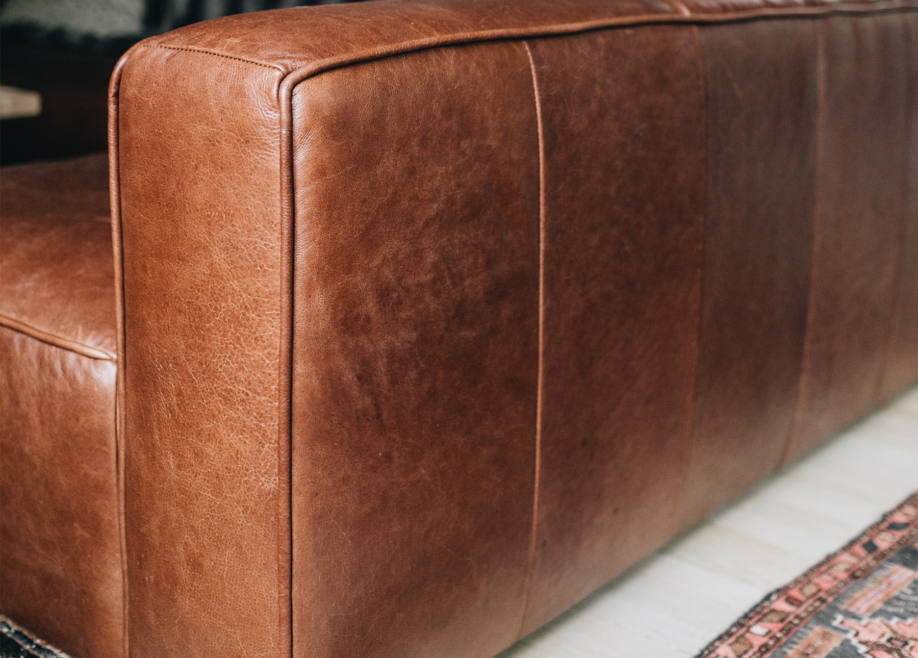 Natural variation and texture in rich, full grain brown leather.