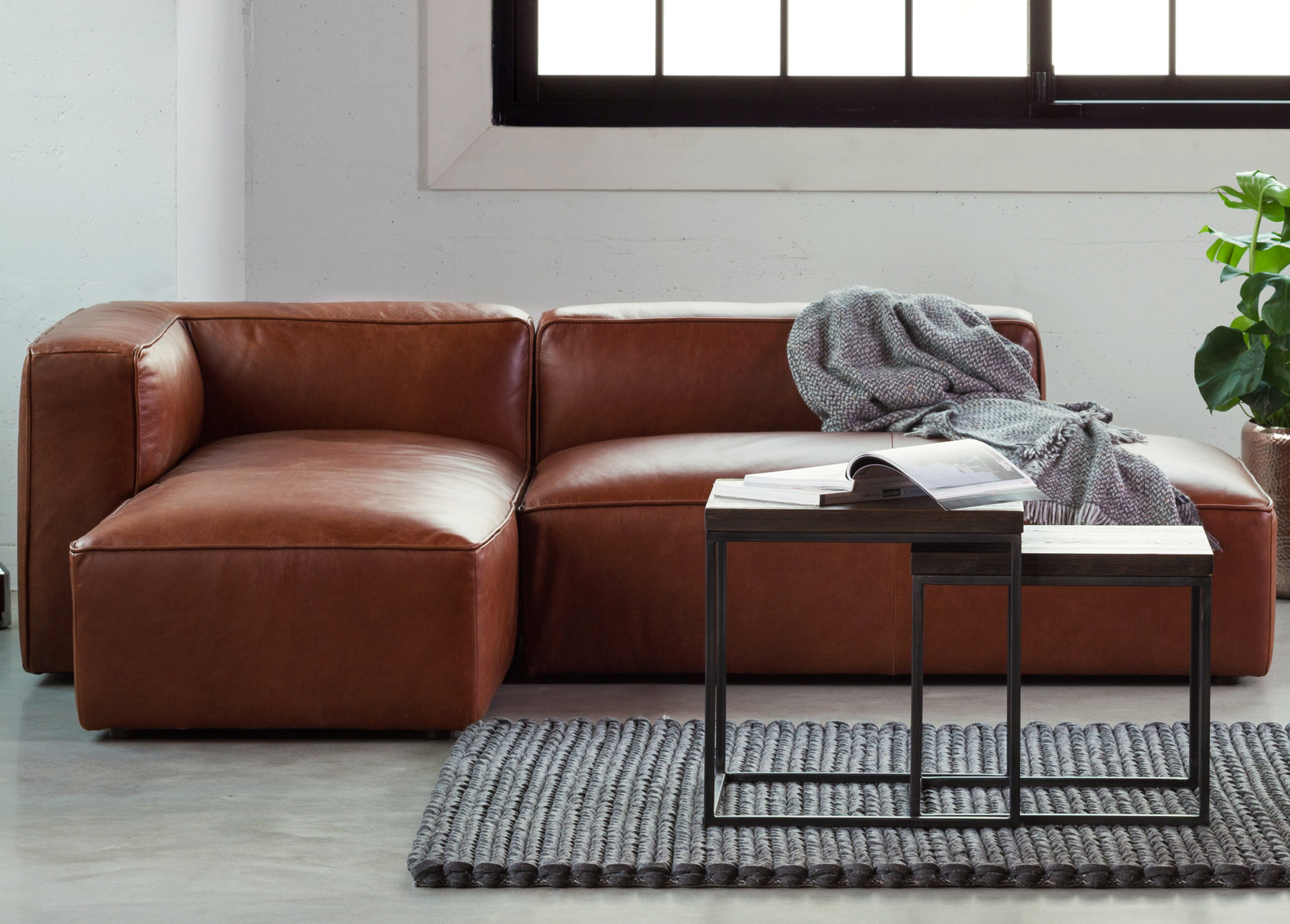Mello Taos Brown left sectional sofa with coffee tables and rug