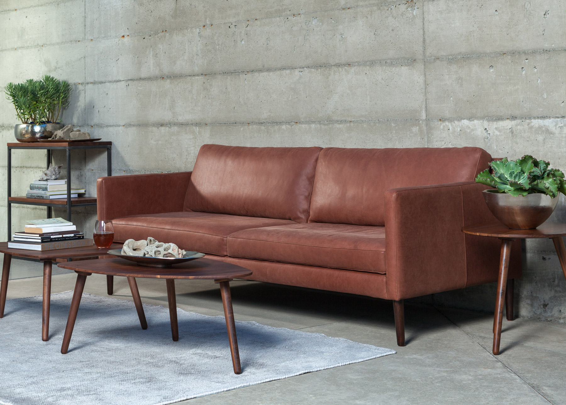 Echo Primo Sedona Brown Sofa with rug, coffee tables, and side table