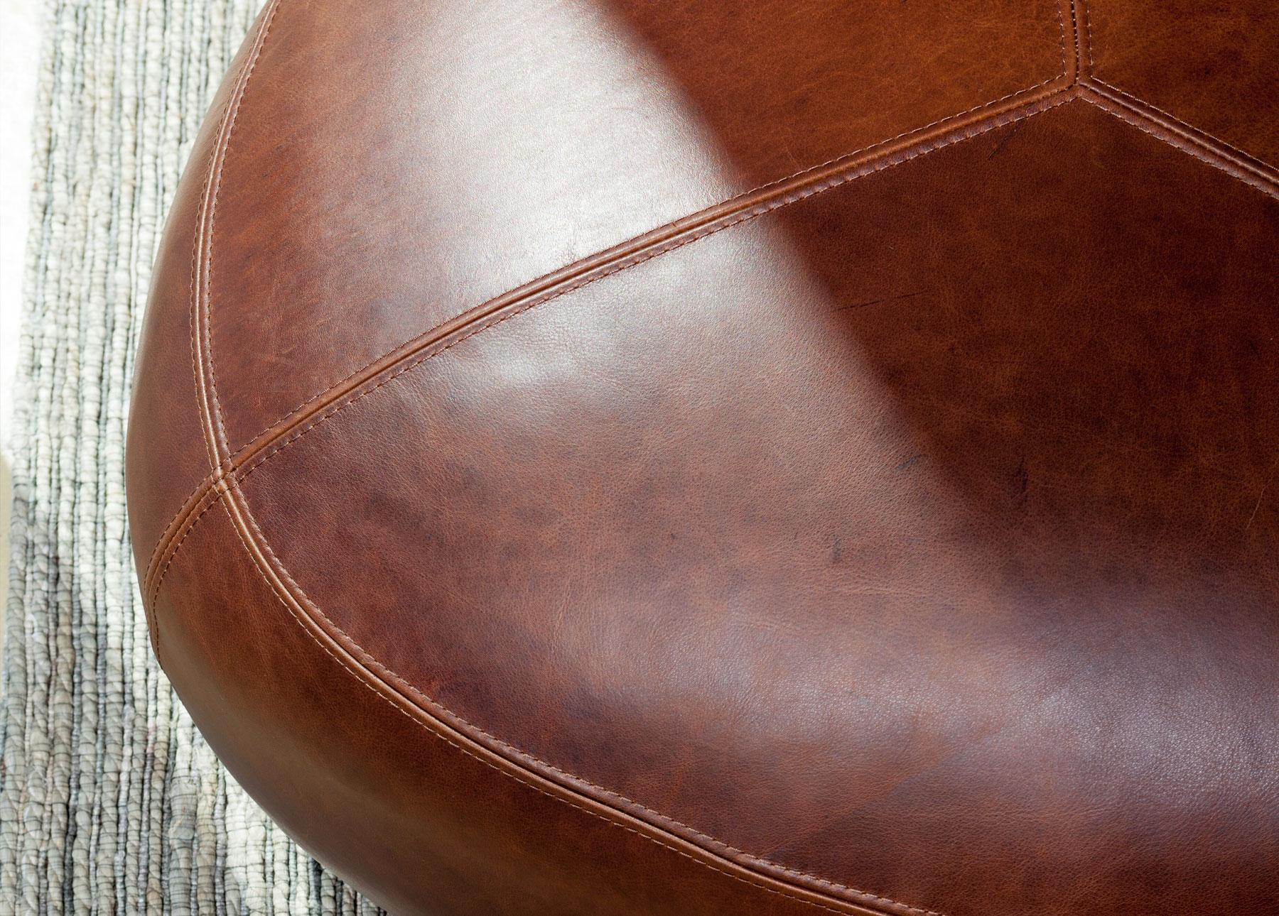 Stone Rawhide Brown Ottoman on a rug
