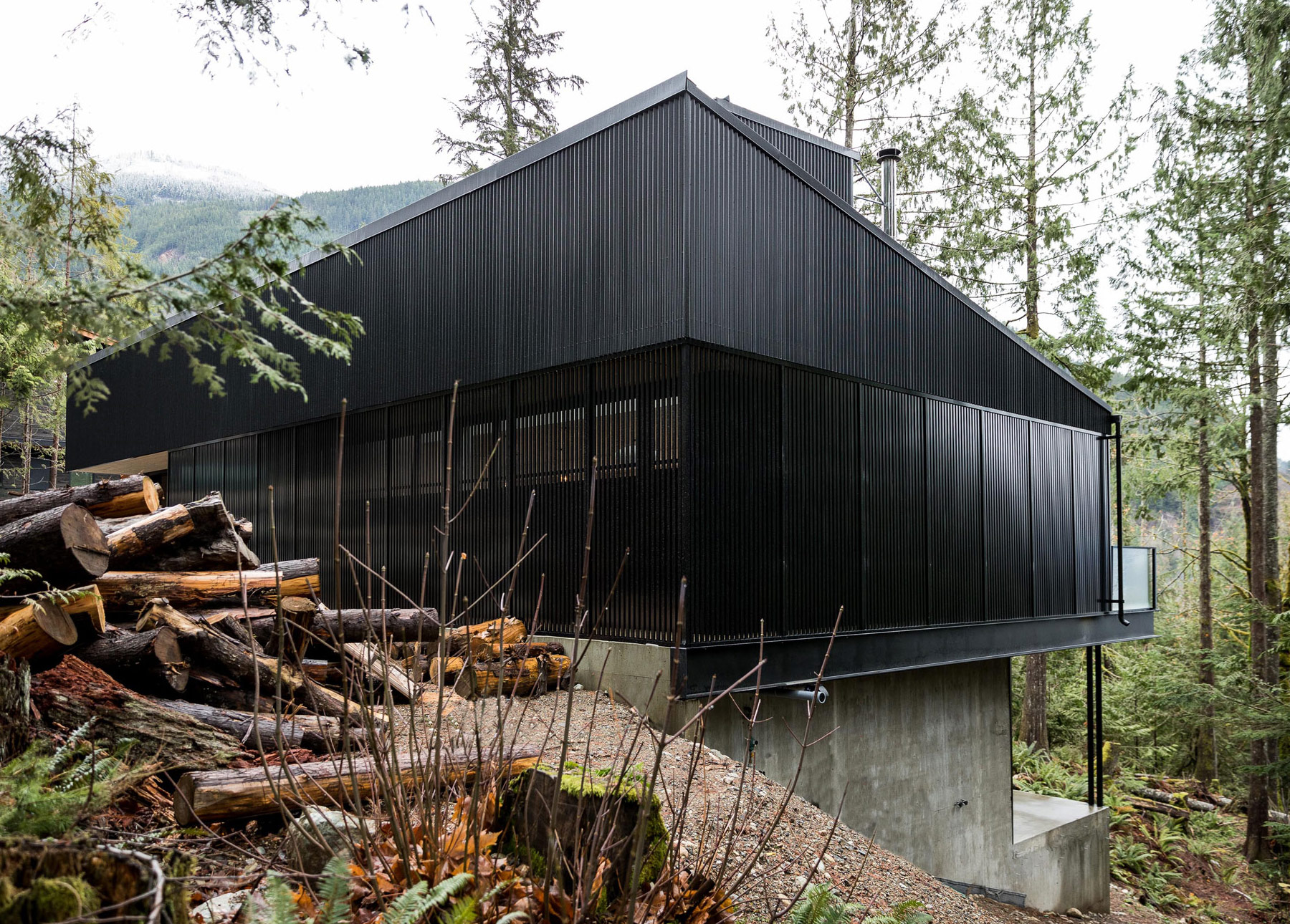 A westcoast contemporary cabin escape articulate for Cost of building on a steep slope