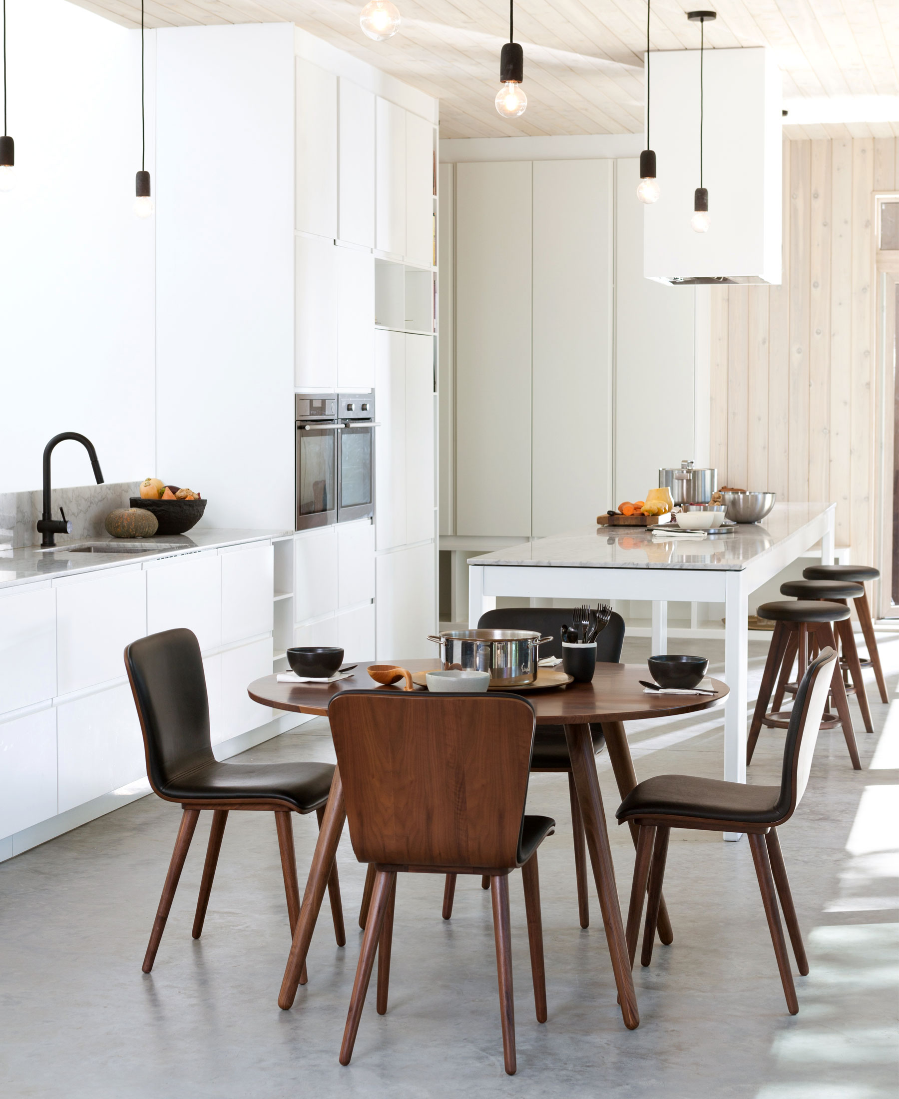 A modern Scandinavian-inspired open-concept kitchen and dining area.
