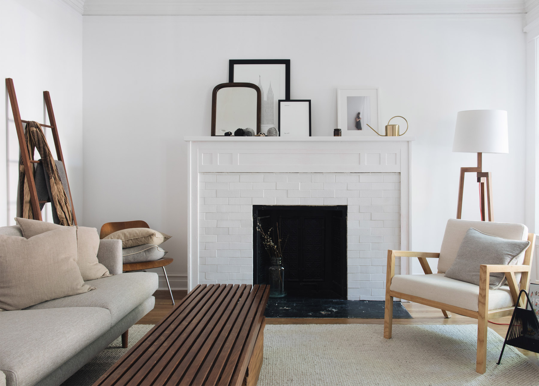 A white fireplace in a minimalist home.